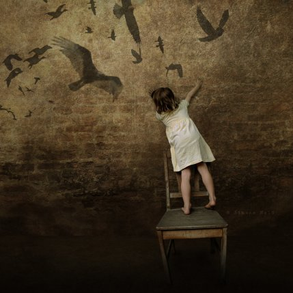 The birds are make-believe. They are not there. Neither is the girl who seems to believe it and you watching it. Ultimately speaking it is all make-believe. The image is grabbed from cyberspace.
